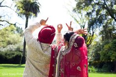 An Indian bride and groom pose for darling wedding portraits.