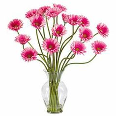 "Brimming with natural appeal, this faux gerbera daisy arrangement brings a bold pop of color to your decor.    Product:  Faux floral arrangement Construction Material: Silk and glass Color: Pink  Features: Includes faux gerber daisies18 Colored stems  Artificial water set in glass vase   Dimensions: 21"" H x 18"" Diameter"