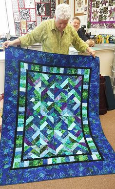 "This quilt is for the Jelly Roll enthusiast.  The body of the quilt is made using 2 1/2"" strips.  Pick your favorite Dragon Roll, Bali Pop or other 2 1/2"" strip pack and go to town.  Finished sizes:  Crib:  52"" x 67""   Lap:   64"" x 79""Twin:  79"" x 94""Queen:  94"" x 109"""
