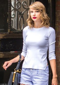 Picture-perfect: The star wore her honey blonde shoulder-length locks in a pretty wavy style with a sideswept fringe, while she sported her signature winged eyeliner and ruby red lips