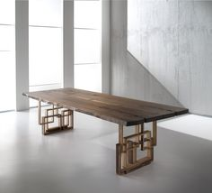 The Leonard dining table features uniquely constructed sculptured legs as this contemporary piece, exclusive to Fanuli furniture, is the latest in design trends...