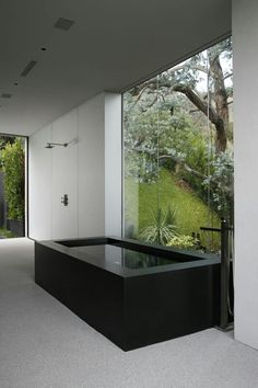 Very modern contemporary simple black bath tub! Look at the severe modern clean lines - against that huge window! What a Zen bathroom - and just think of having a shower in that open shower stall! Modern Bathtub, Modern Bathroom Design, Bathroom Interior Design, Black Bathtub, Interior Livingroom, Modern Interior, Modern Furniture, Modern Design, Bad Inspiration