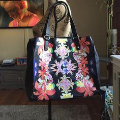 "Cosmopolitan floral handbag In new like condition...very cute...measurements are 20""13""5...strap drop is 9 inches Cosmopolitan Bags Totes"