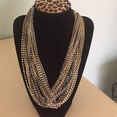 Beautiful braided mixed metal necklace! Made of interlocking chains in mixed metals this necklace accents every outfit! Never worn. Without tags. Jewelry Necklaces