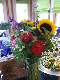farmers's market bouquet with zinnias and sunflowers