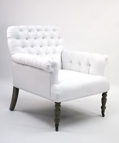 upholstered lorraine tufted arm chair offers a club chair 39 s potential