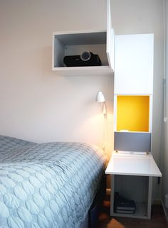 Home cinema nightstand - BESTA unit mounted at the top to house the projector