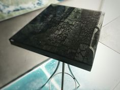 Burnt wood top with epoxy resin.  Ccoating by genesispd.nl