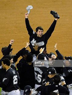8ecafd936 The Florida Marlins hoist up pitcher Josh Beckett the 2003 World Series MVP  after defeating the