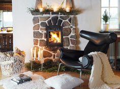 Un salon avec cheminée en pierre / A livingroom with a fireplace made of stones : http://www.maison-deco.com/salon/deco-salon/Un-salon-cosy