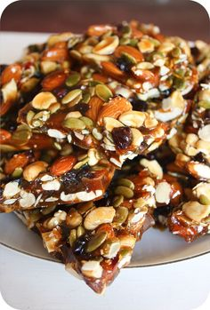 BRITTLE recipe.  1 Cup Almonds  1 Cup Cashews  3/4 Cup Pumpkin Seeds  2/3 Cup Dried Cranberries  2 and 1/4 Cups Granulated Sugar     1/4  Cup Golden Brown Sugar  1/2 Cup Honey  1 Cup Water  1/2 Teaspoon Salt  1 Tablespoon Butter