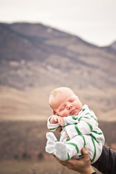 A safe and content baby with a vast landscape just beyond.  A beautiful visual statement!