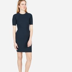 Simple, meet sporty.  A form-fitting, extra-flattering tee dress with reverse jersey paneling at the sides for a perfect fit. How to show-off—without losing your cool.
