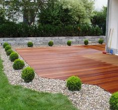 lovely wooden terrace with surrounding plants.  This would look great surrounding a pool too