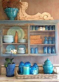 My kitchen cupboard filled with blue dishes. hueandidesign.typepad.com