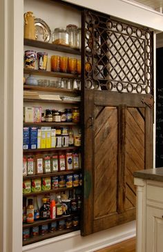 This space is created by opening the space between the studs in the wall. Small, skinny spot, but look at all of the fabulous storage with small pantry items that take forever to find - a great idea to steal space and have a big impact. via Design Sponge