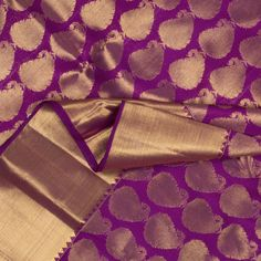Gorgeously designed paisleys in zari fill the entire expanse of the ravishing purple body. The attractive pallu features a shimmering spread of zari woven with annams, yazhis, floral vines, temple and vanki motifs. A bavanji border edged with arai madams adds to the richness of the sari. View more details at http://www.parisera.com/products/kanakavalli-handwoven-kanjivaram-silk-sari-100100638?cid=33