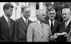 Congressman John F. Kennedy with President Truman.