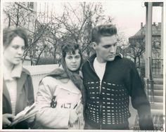 This picture was taken in front of Elvis's rented house at Goethestraße 14 in Bad Nauheim, Germany, sometime in 1959. From left to right: German fan Gisela Käthe Kocks who sadly passed away in 2014 and her American girlfriend, 16-year-old Ute Ettinger-Mekhail with Elvis Presley. (At the time Ute didn't speak German.) Also take a look at: https://de.pinterest.com/pin/380906080959474033/ and also https://de.pinterest.com/pin/380906080959473937/