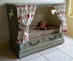 Chalky Finish paint helps turn an old television cabinet into a dog bed.