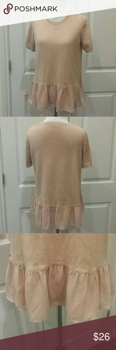 "Ruffle Hem Sweater This top is super cute, with a ruffle bottom. It's a very lightweight sweater perfect for spring and summer.  The ruffle adds a perfect touch of feminine frill to this short sleeve knit top. Round neck, short sleeves, ribbed neckline and cuffs. The color is a light peach, and it's still in very good condition, shows a tiny bit of wear but not very noticeable.  Length front: 22"" Length back: 24 1/2"" Armpit to armpit: 17"" LOFT Tops"