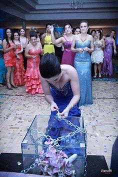 Instead of a chaotic bouquet toss, lock the bouquet in a box and hand out random keys for ladies to try.