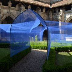 'Les Voûtes Filantes' (The Shooting Vaults) by Paris studio Atelier YokYok. Thousands of thin blue strings create tunnels across the cloister garden. installation: the Gothic-style cloister at St Stephen's Cathedral, Cahors, south-west France. via dezeen String Installation, Art Installations, French Cathedrals, Art Et Architecture, Art Public, The Cloisters, Land Art, Medieval, Street Art