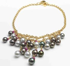 Assael Pearl Collection SOLD, NO LONGER AVAILABLE Tahitian Pearls and ruby necklace Twenty-five Natural color Tahitian cultured pearls, 12-10.1mm Twenty-five Rubies, 26.50 cts total weight 18k yellow gold Secure clasp