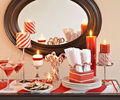Dress your buffet table in red-and-white stripes for your next party. Tie red ribbons around white candles, wrap napkin holders with red paper, and lay a striped table runner to direct attention (and hungry guests