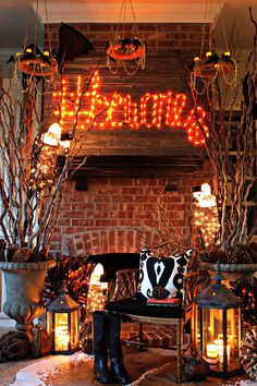 We love the Halloween decorations for this living room and fireplace mantel. The DIY lighted sign, Halloween chandeliers and lanterns create the glow. The tree branches add texture. The top hat-wearing vultures provide the whimsy. Jennifer Griffin of Dimples and Tangles explains her creative process on The Home Depot Blog. || @dimplestangles