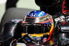 Fernando Alonso with his chrome Singapore helmet.