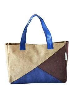 Showcase your class, style, a sense of eco-consciousness even while you are in office. This Jute handbag on your desk will surely start some interesting conversations. Match this with western formals to complete your look.  http://www.earthenme.com/New-Arrivals/Jute-3-Colour-Office-Handbag-id-1999104.html