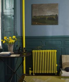 I LOVE the way the old radiator is highlighted in this space!!!  Contemporary Hallway with Paint 3, Hardwood floors, Area rug, Paint, Exposed pipes, Wall mounted radiator, Built in storage