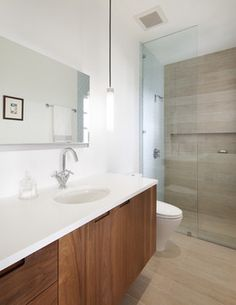 Oh I love the way this looks like wood and the accent wall of tile in the shower. Great idea