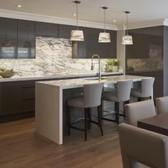 In this kitchen we matched the Arabescato marble splash back to the light fittings for a statement design