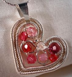 Duplicate Hearts Pendant with wired beads  some day...