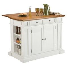 """Kitchen island with an oak-finished top and antiqued nickel hardware.  Product: Kitchen islandConstruction Material: Wood and nickel hardwareColor: White and oakFeatures:  Antiqued nickel hardwareOpen storage with three adjustable shelves on each endTwo drawersOne cabinet with two adjustable interior shelves11.75"""" Drop leafFinished backDimensions: 36.5"""" H x 49.75"""" W x 26.5"""" DNote: Assembly required"""
