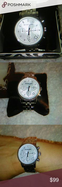 MICHAEL KORS STAINLESS STEEL CHRONOGRAPH WATCH Excellent condition worn twice, Michael Kors Women's Classic Stainless Steel Chronograph Watch featuring a Mother of pearl face/dial.  This is simple elegance at its best!  Perfect for work or that all important job interview!  Treat yourself today. Michael Kors Accessories Watches