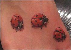 Cute three ladybugs tattoo