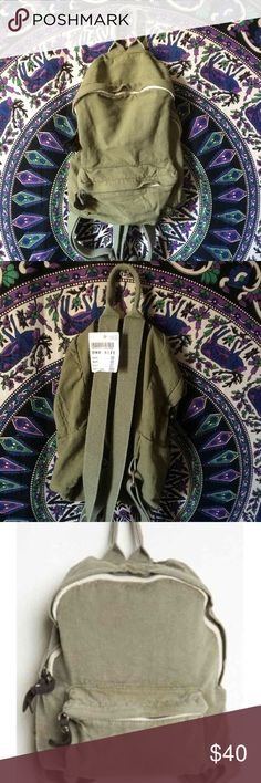 Brandy Melville backpack Brandy Melville MINI backpack. Olive green? NWT will only lower through PayPal or mercari ( use code QMPQSD when signing up for an account to get $2 off ) Brandy Melville Bags Backpacks