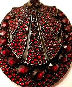 "VICTORIAN Antique GARNET Mourning Hair Pendant, movable tops. There is a glass back that opens for hair to be placed in it. The unsigned pendant measures 1 5/8"" tall x 1 1/4"" wide."