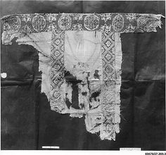 Tunic, fragment    Object Name:      Tunic, fragment  Date:      6th–7th century  Geography:      Egypt  Medium:      Linen, wool  Dimensions:      38.5 in. high 31.00 in. wide (97.8 cm high 78.7 cm wide)  Classification:      Textiles  Credit Line:      Gift of H. A. Elsberg, 1927  Accession Number:      27.209.3  Metropolitan Museum of art
