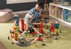 The KidKraft Super Highway Train Set is a winding, high-trestle train set that raises imaginative fun to a new level. With more than 80 pieces, including three-tiered bridges, tall skyscrapers and an elevated train station, kids will love how the three-ca Felt Play Mat, Wooden Playset, Multiplication For Kids, Wooden Train, Play Spaces, Train Set, Classic Toys, Model Trains, Slipcovers