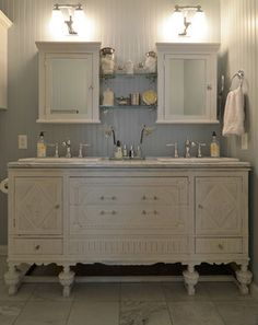 http://www.houzz.com/photos/4526942/Abilene--TX--Camille-Dickson-traditional-bathroom-other-metro The dual vanity created from an antique buffet found at a consignment store for $200. After painting it white, the couple topped it with a Carrara marble remnant from a local stone yard.