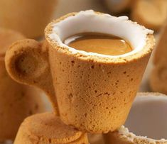 Edible Cookie Coffee Cup: pastry covered with a special sugar that works as an insulator making the cup waterproof and sweetening at the same time. Made for Italian coffee brand Lavazza.