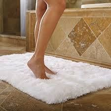 Tip of the Day Bathroom Mats These are another thing that get used on a daily occasion but probably don't get washed as much as they should. Think about all the mildew and germs they gather everyday, yuck. Wash on the hottest temperature you can (throw in some towels for scrubbing help), then tumble dry low. If needed, use a little cleaning brush to fluff it back into shape. Also, this is another one I recommend having backups for.