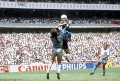 Argentina's Diego Maradona scores their first goal with his hand over Peter Shilton of England Soccer World, World Football, Football Boys, History Of Soccer, Diego Armando, Famous Sports, International Football, Rugby League, Sports Photos