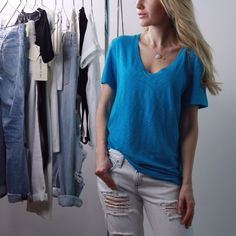Rag + Bone V Neck Tee Rag + Bone classic V neck tee shirt with a relaxed fit and longer length. Color is called Aqua on the tag - a very pretty turquoise shade. Seam down back. 100% cotton. The best designer tees out there. Retails $80 in store. Brand new with tag. Size M. rag & bone Tops Tees - Short Sleeve