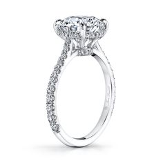 ANNA is a handcrafted Jean Dousset Diamonds solitaire engagement ring with one row of diamonds on the band and pictured with a Round cut diamond in Platinum.