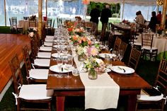 Rustic reception decor under a tent at Mt. Hope Farm in Bristol. Photo by Oggi Wedding Photography.